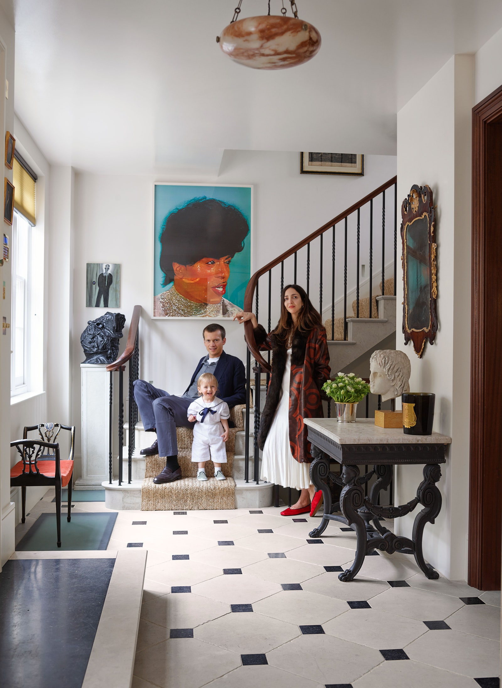 Guinness Weinstock and son Reuben in the entrance hall. The portrait of Little Richard is by Mark Leckey.